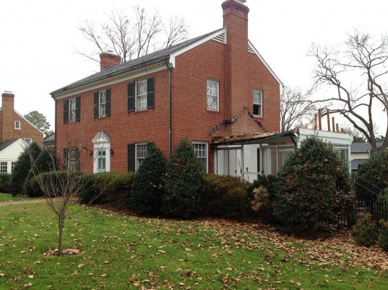 A typical colonial gets an addition to accommodate a for Colonial home additions
